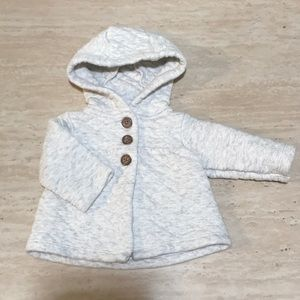 Light grey coat with brown buttons